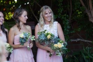 Maid of honor and bridesmaids with succulent bouquets.