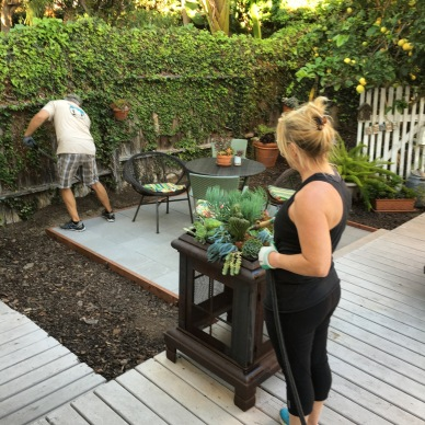 Changed an old fireplace into succulent container and added paver patio